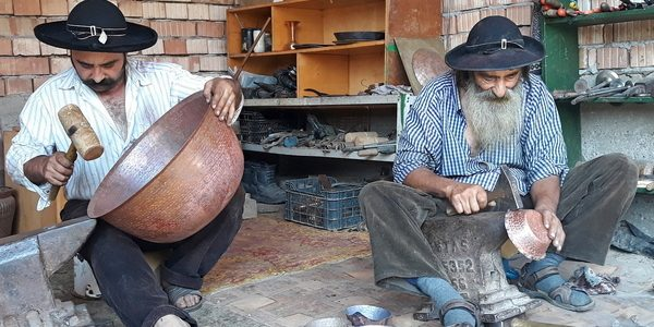 Gypsy father and sun coppersmith craftsmen, Transylvania