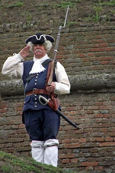 guard dressed in 18th century Austrian uniform in Alba Iulia